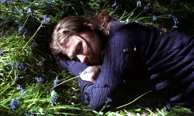 Aphex Twin laying in grass